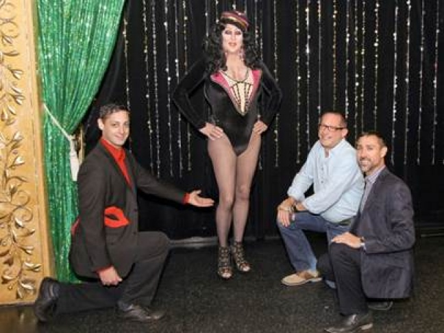 "Left to right, Sean Engler, ""Franchesque Richards"" dressed as Cher, Glen Weinzimer and Michael Goodman promote the annual SMART Ride's launch party ""Never Say Farewell-Tribute to Cher"""