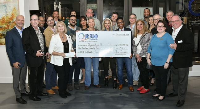 Grantees with check during Our Fund Foundation Fall 2018
